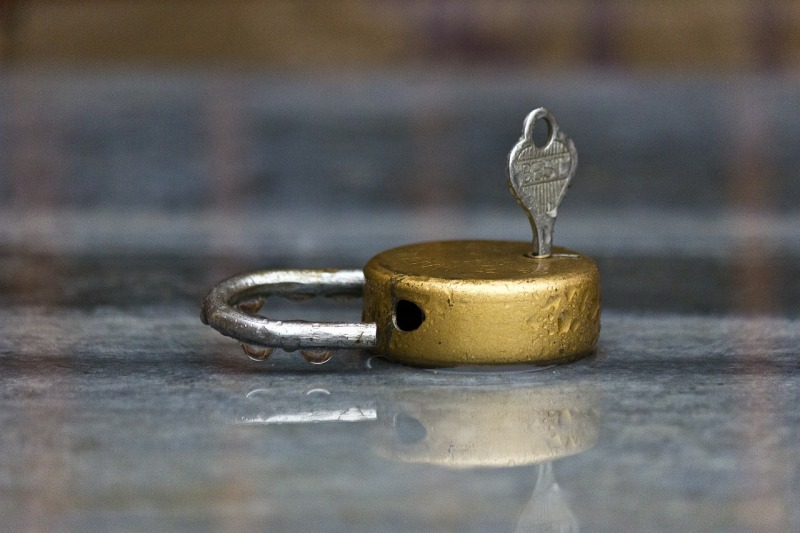 padlock and key about to turn